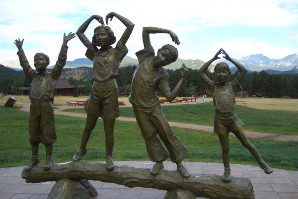 bronze statue of children at YMCA in Estes